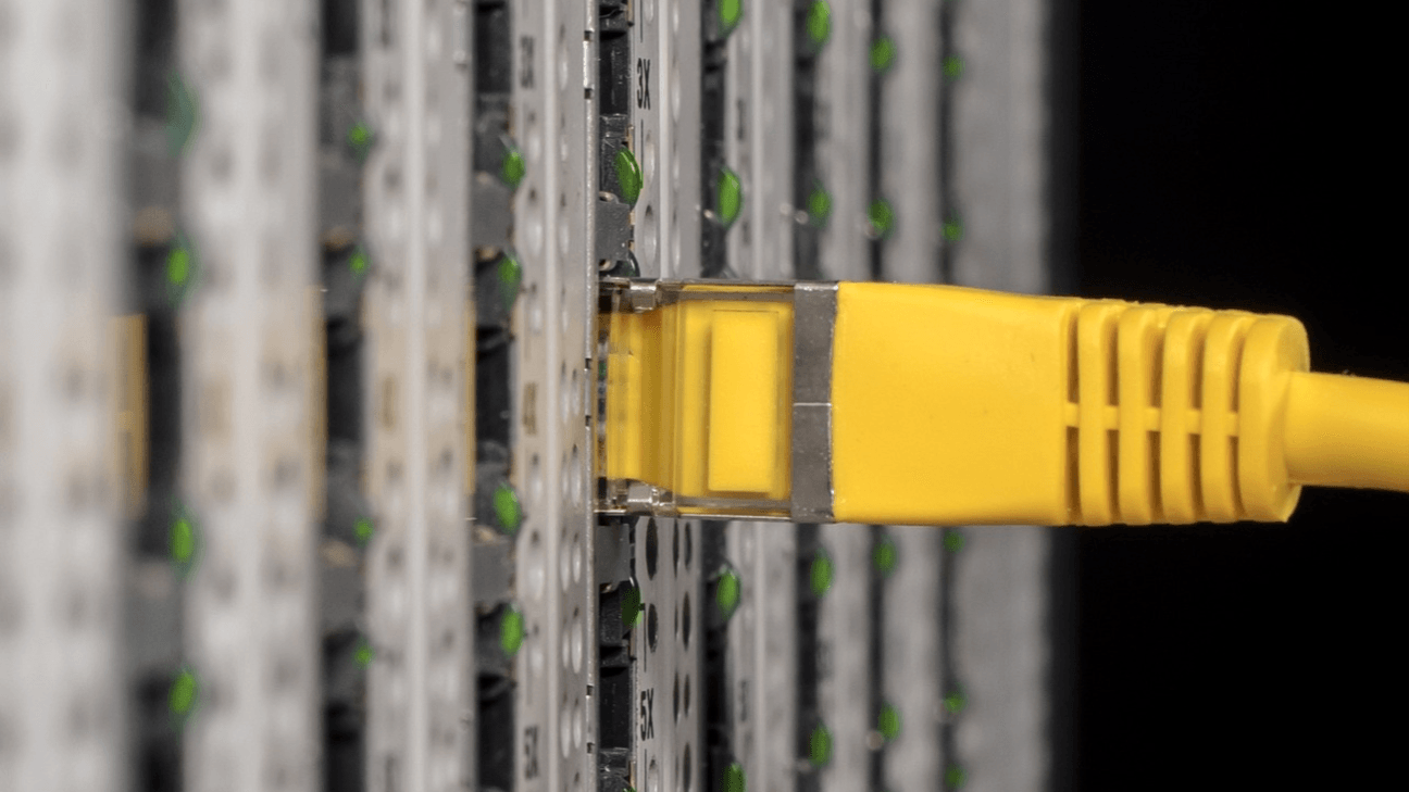 A yellow cable plugging into a server