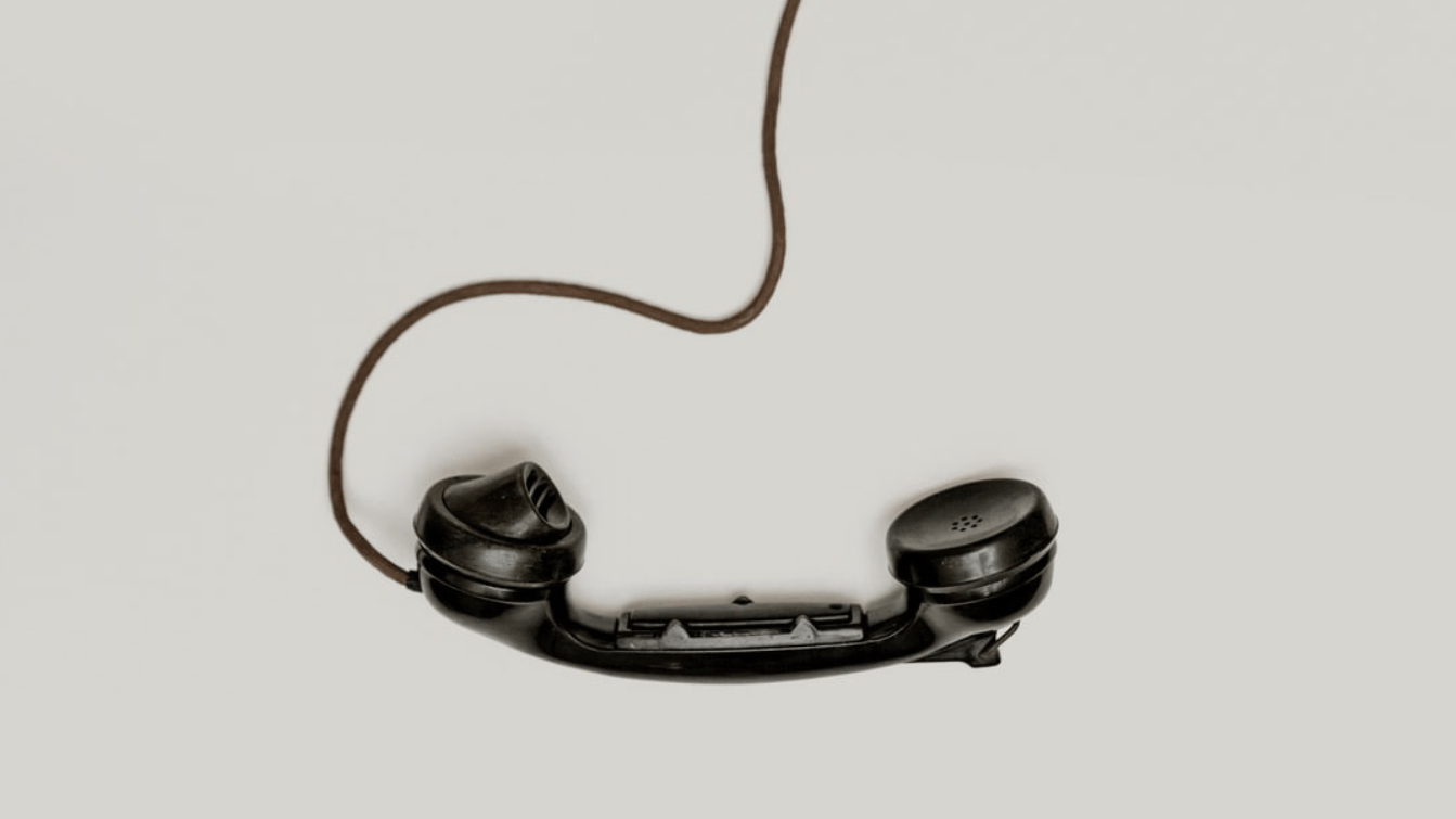 A old telephone hanging by the cord