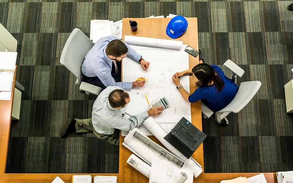A top down shot of a meeting around a conference table