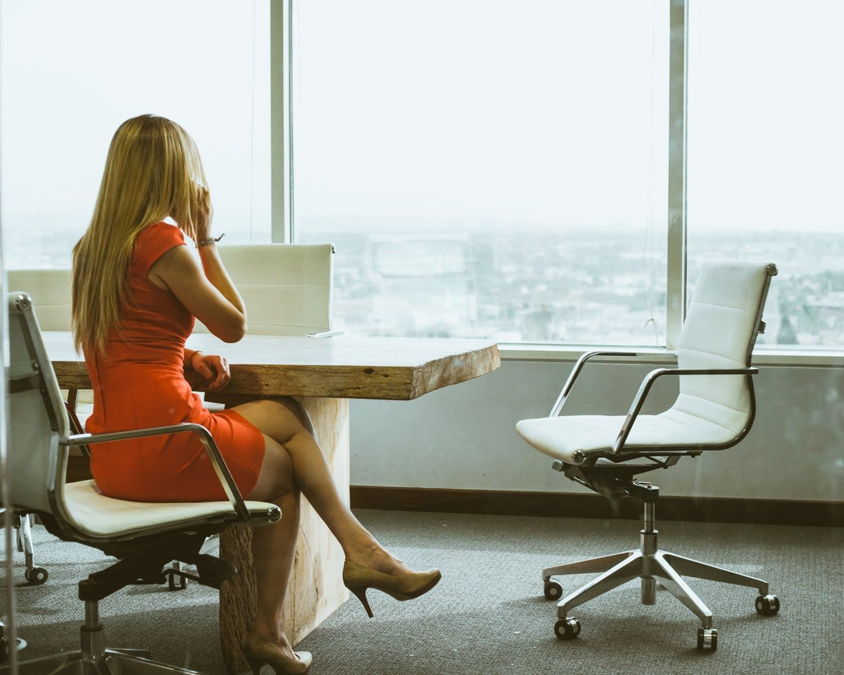 A woman in an office looking out a window