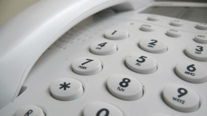 A close up shot of a landline phones numbers